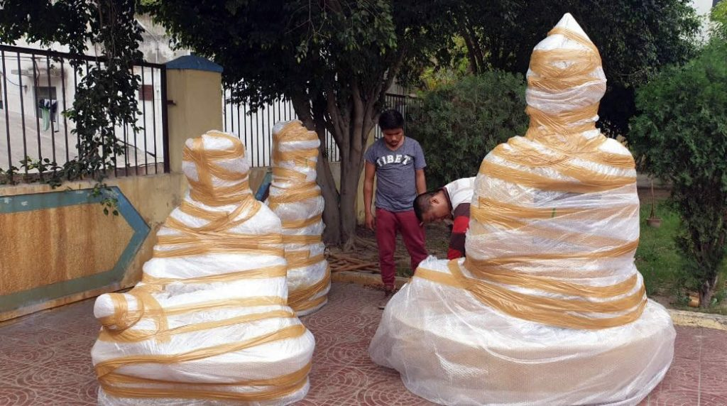 Statues of Shakyamuni Buddha, Guru Rinpoche and Terdag Lingpa, the founder of Mindrolling, are wrapped in India for the ocean-journey to Lotus Garden.