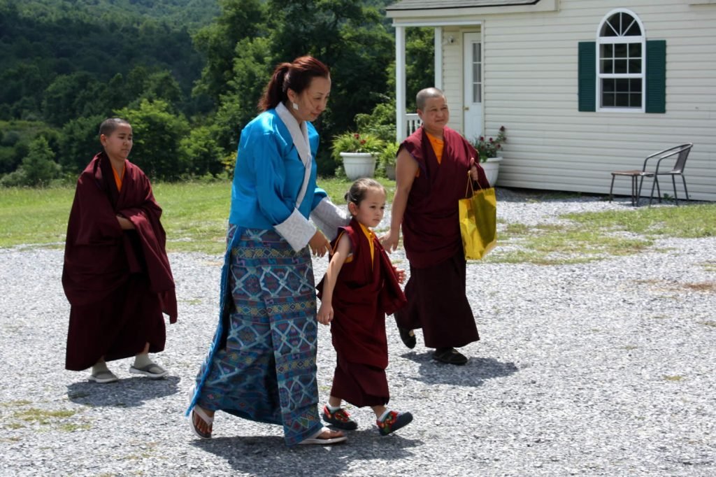 Dungse Rinpoche and his mother, Jetsun Dechen Paldron, arrive at the main shrine room