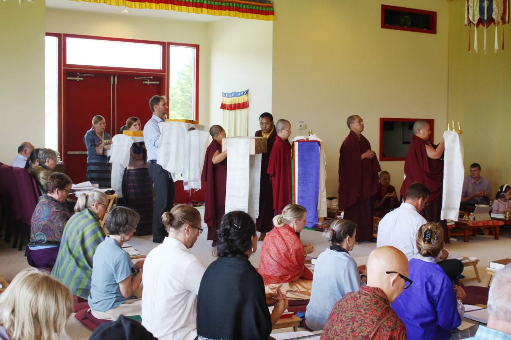 Offerings are made to His Eminence Dzigar Kongtrul Rinpoche at the conclusion of the teachings