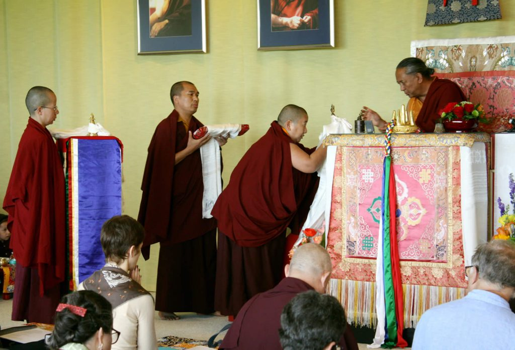 H.E. Jetsün Khandro Rinpoche makes the Body, Speech and Mind Offerings to H.E. Dzigar Kongtrul Rinpoche