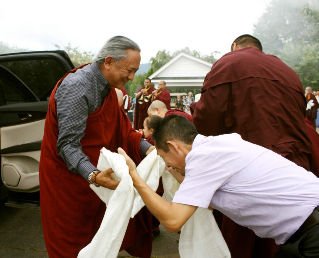H.E. Dzigar Kongtrul Rinpoche is welcomed by Dr. Tsewang Rigzin