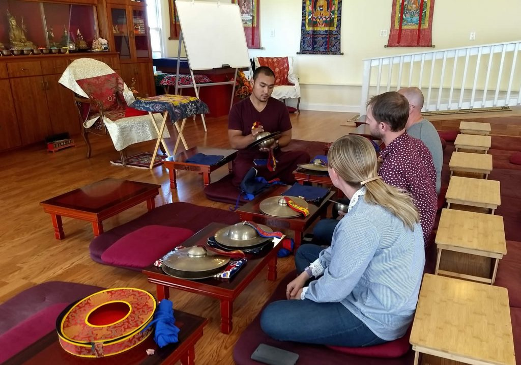 Ven. Choktrul Ngawang Jigdral Rinpoche teaching the<em> rolmo</em> and <em>silnyen</em>