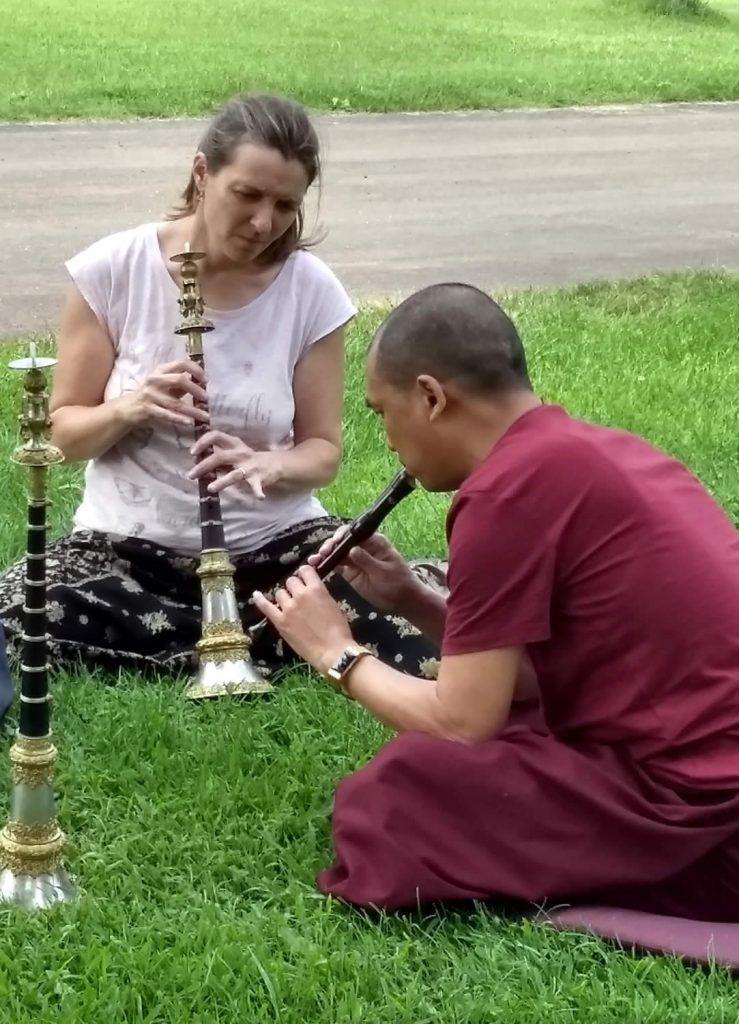 Ven. Lama Thrinley Gyaltsen and student practicing <em>kangling</em>