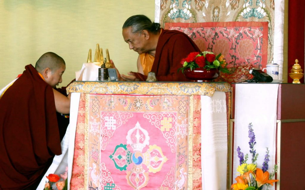 H.E. Jetsun Khandro Rinpoche makes the mandala offering to H.E. Dzigar Kongtrul Rinpoche at the conclusion of the teachings