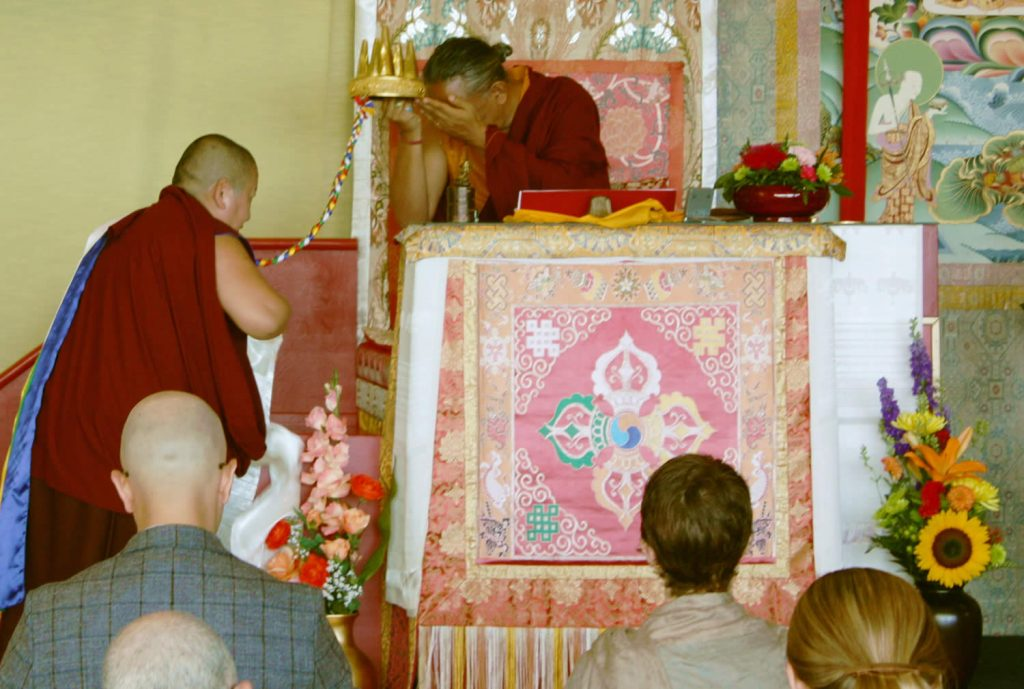 H.E. Jetsün Khandro Rinpoche makes the mandala offering