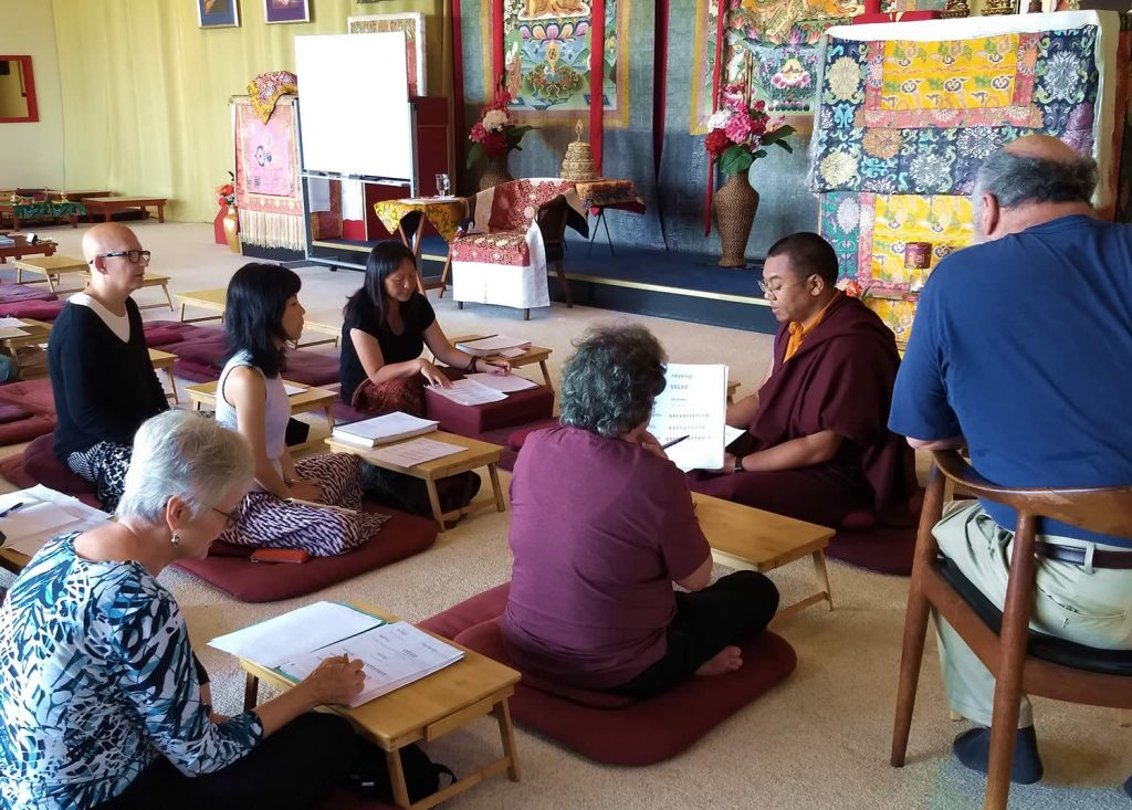 Ven. Khenpo Namdrol Gyatso la leads a Tibetan language reading class