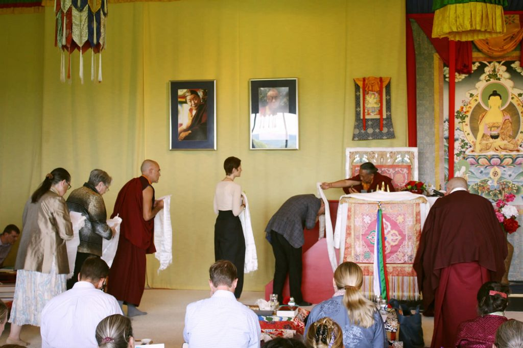 Offering khatags to H.E. Dzigar Kongtrul Rinpoche