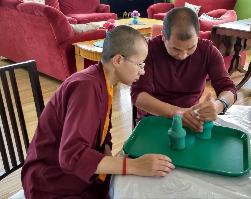 Ven. Lama Thrinley Gyaltsen la and student during torma class