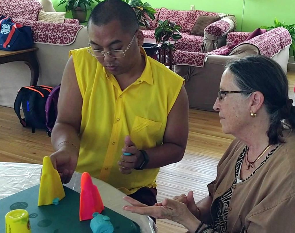 Ven. Lama Thrinley Gyaltsen and student during torma class