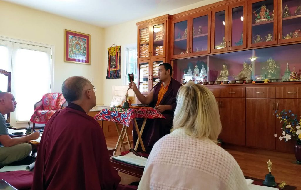 Ven. Choktrul Ngawang Jigdral Rinpoche and students review the Vajrasattva (Minling Dorsem) liturgy