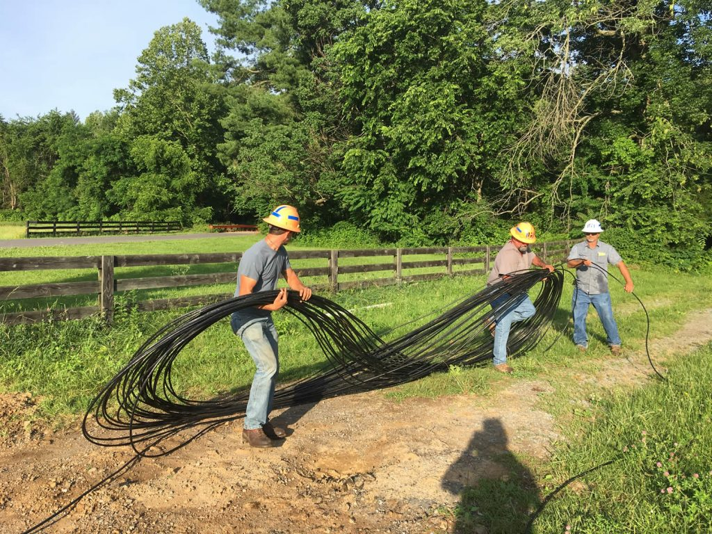 PennLine workers preparing fiber optic cable for pulling.