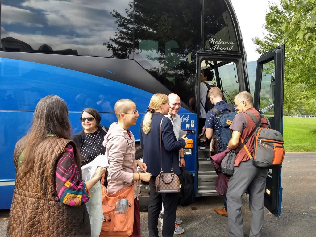 Lotus Garden Sangha Members board bus for trip to airport