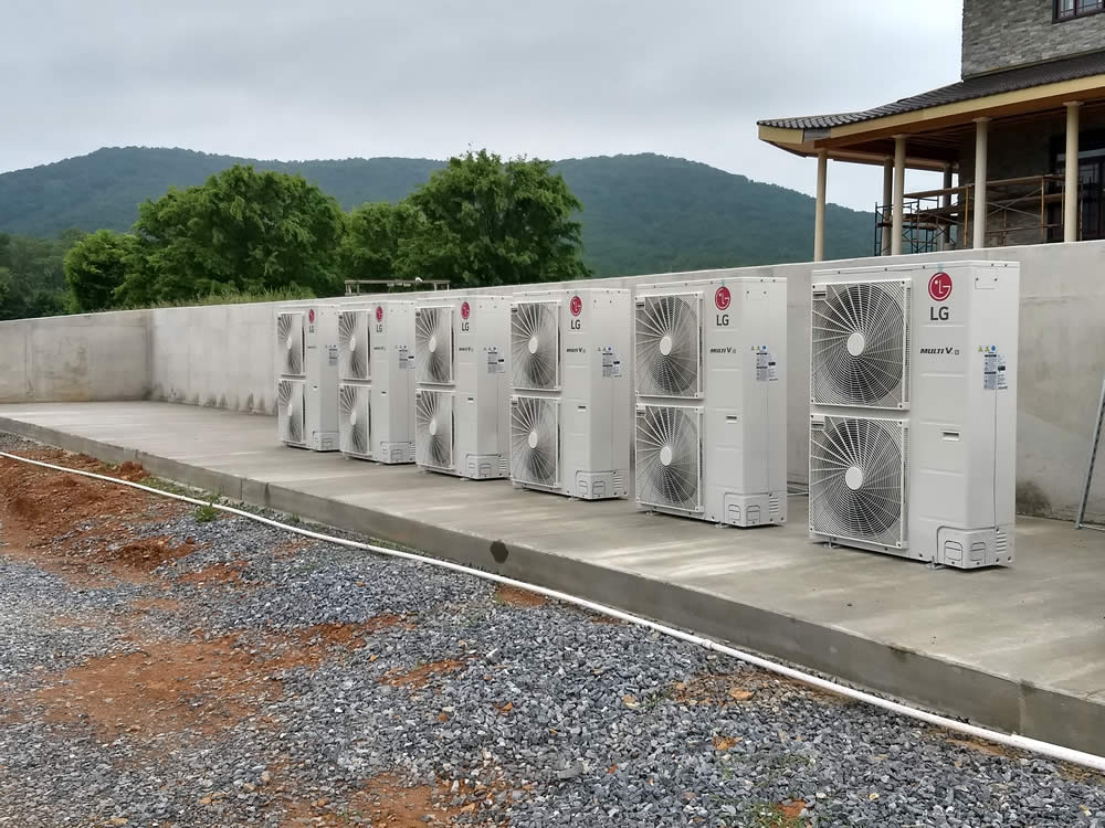 HVAC units are installed outside the temple.
