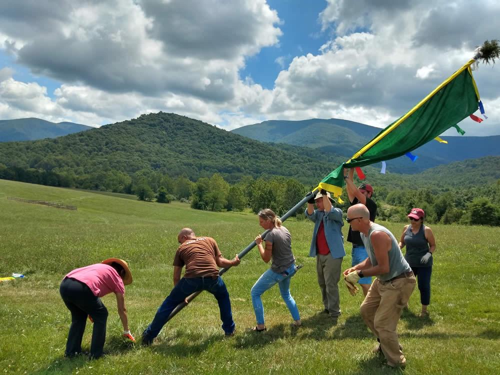 Raising new prayer flags at Mindrolling Lotus Garden.