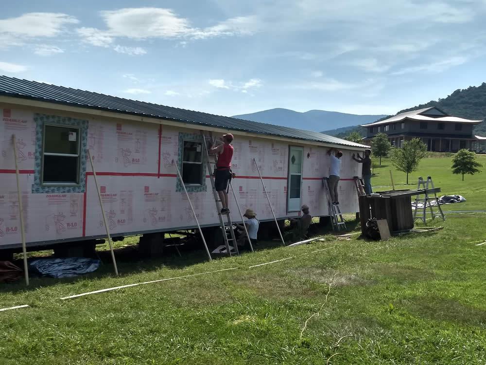 Applying moisture barrier to the trailer.