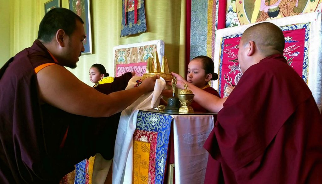 Ven. Choktrul Ngawang Jigdral Rinpoche offers the mandala to Minling Dungse Rinpoche