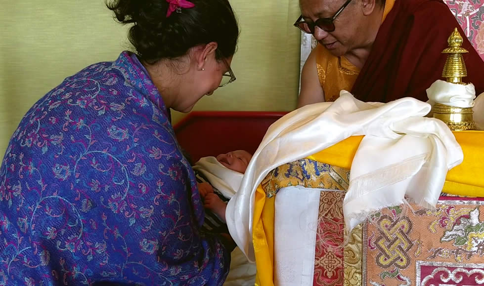 His Eminence Dzigar Kongtrul Rinpoche blessing the youngest sangha member