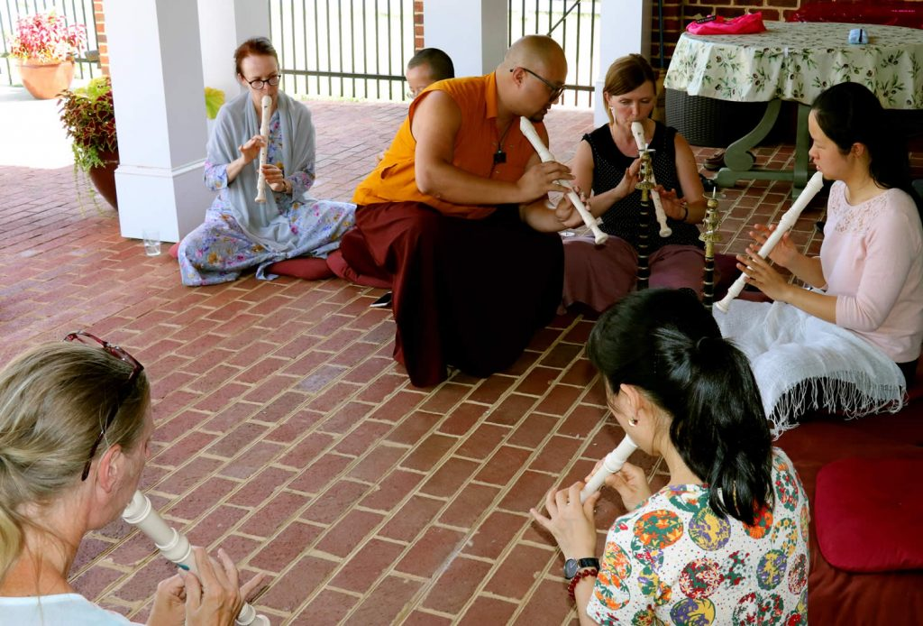 Ven. Lama Sonam Tobgay working with gyaling students