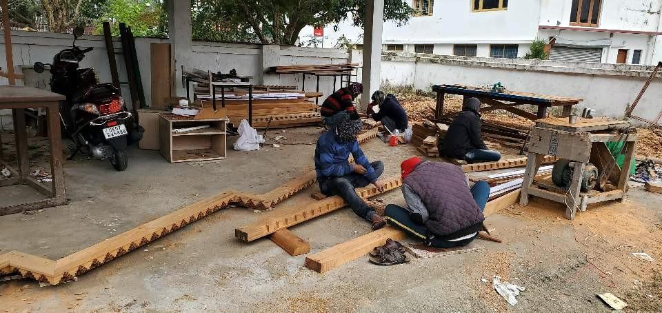 Artisans carving shrine pieces.